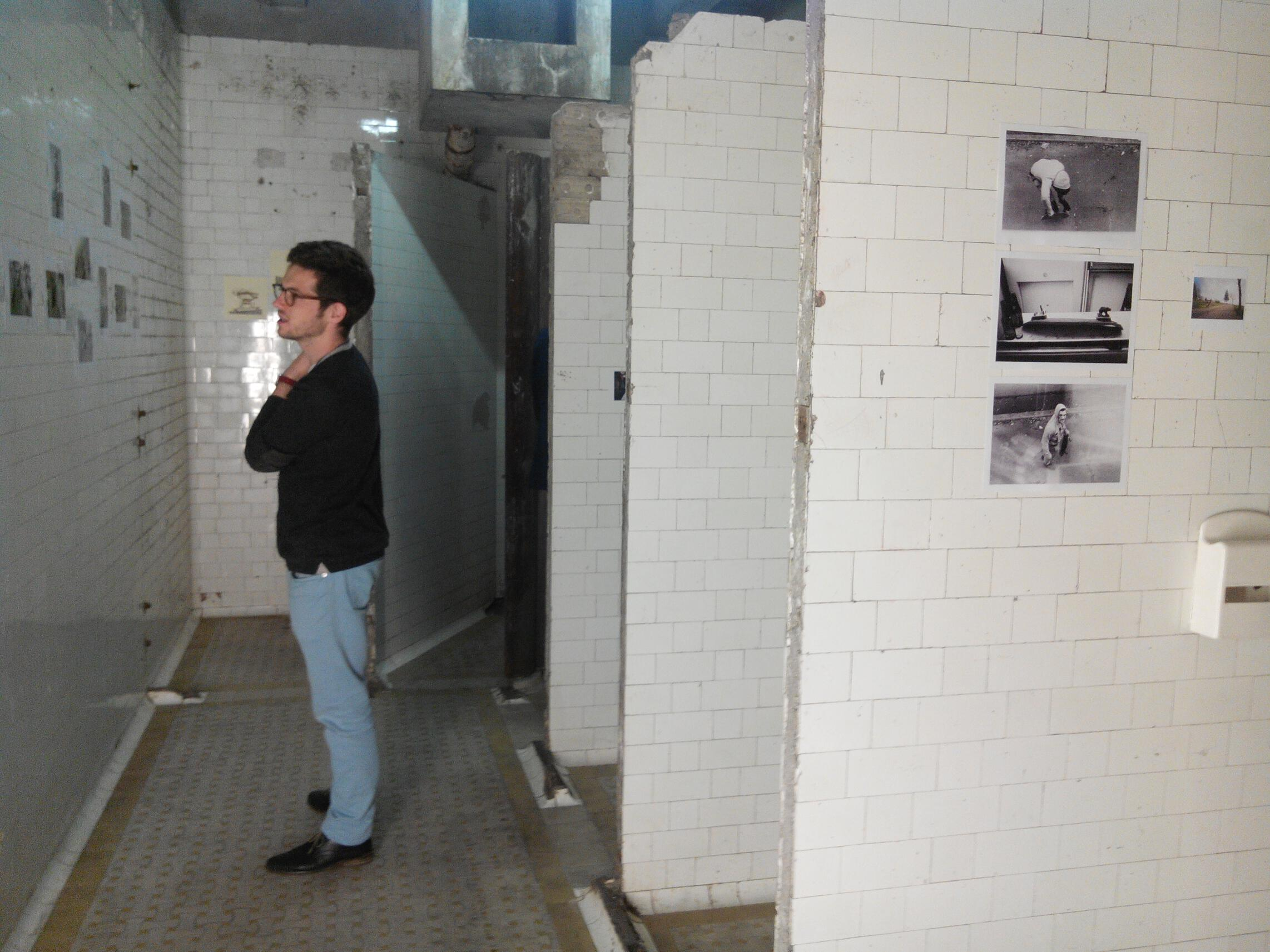 20140830 museum night Photo 10 _ looking at the photos on the wall of an old public toilets in Paris.